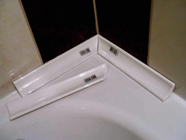 установка уголка на ванну